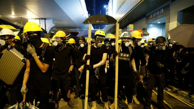 Protesters prepare to confront riot police in Hong Kong on Sunday. Photograph: Vincent Yu/AP