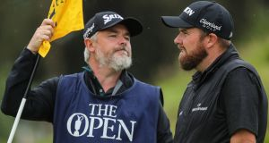 "Shane Lowry with his caddy Brian Martin. ""Bo has been incredible the last year. He's brought a new lease of life to me. He is so thrilled. He was unbelievable today."" Photograph: Oisín Keniry/Inpho"