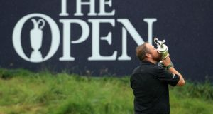 Shane Lowry of Ireland celebrates with the Claret Jug on the 18th green at Portrush. Photograph: Getty Images