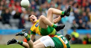 Donegal's Jamei Brennan  and Kerry's Mark Griffin take a tumble during yesterday's quarter-final phase two clash at Croke Park. Photograph: Ryan Byrne/Inpho