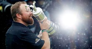 Shane Lowry celebrates with the Claret Jug trophy after winning The Open Championship. Photograph: Jason Cairnduff