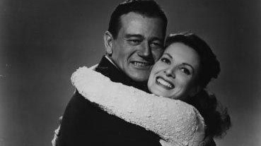 Irish actor Maureen O'Hara with John Wayne in a publicity still for 'The Quiet Man'.