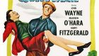 A poster for John Ford's 1952 comedy 'The Quiet Man' starring John Wayne, Maureen O'Hara, and Barry Fitzgerald.