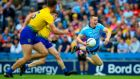 Roscommon's Conor Daly fouls Con O'Callaghan of Dublin and is red-carded during their quarter-final phase 2 match at Croke Park. Photograph: Tommy Dickson/Inpho