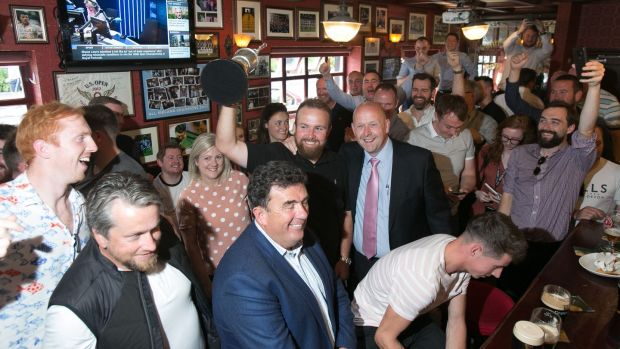 British Open champion Shane Lowry celebrates with fans at the Boar's Head pub in Dublin. Photograph: Gareth Chaney/Collins