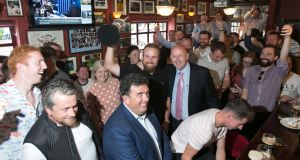 IN FULL SWING: British Open golf champion Shane Lowry celebrates with fans at the Boar's Head pub in Dublin's city centre. Photograph: Gareth Chaney/Collins