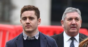 Paddy Jackson with his father Peter arriving at a Belfast court for his son's rape  trial.      At the conclusion of the trial Paddy Jackson (27) and former team-mate Stuart Olding (26), were both unanimously acquitted of raping the same woman. File photograph: Charles McQuillan/Getty Images