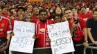 Fans of Manchester United watch their team play Inter Milan at the Singapore National Stadium. Photograph: Lionel Ng/Getty Images