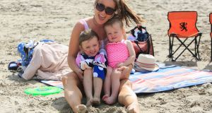 Louise Bruton with her children Hailey (3) and Willow (1)  from Meath enjoying the good weather on Portmarnock Beach on Monday. Photograph:  Collins