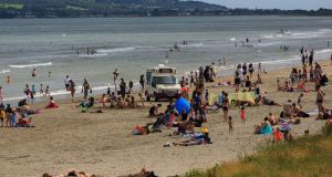 People enjoying the good weather on Portmarnock Beach in Dublin on Monday. Photograph:  Collins