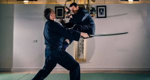 Alex Meehan (right) and Tom Clements practicing ninjutsu