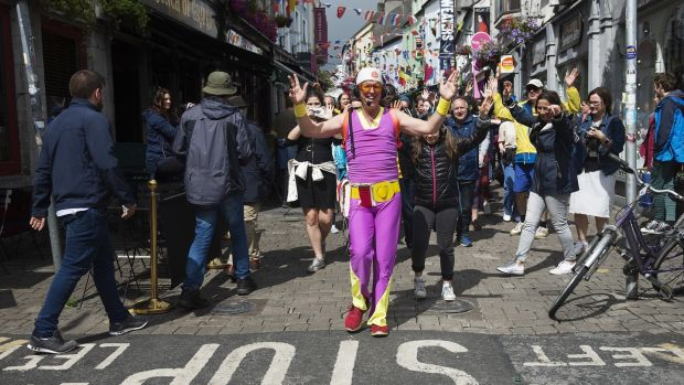 A silent disco walking tour of Galway is not for the self-conscious. People smiled and laughed and photographed our dancing horde led by the purple-synthetic-jumpsuited Australian host. Photograph: Andrew Downes/ xposure