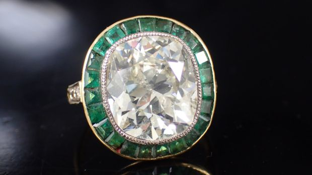 Seven carat diamond and emerald ring. €20,000- 25,000 John Weldon