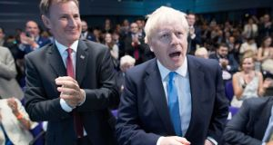 Jeremy Hunt congratulates Boris Johnson after he was announced as the new Conservative party leader. Photograph: Reuters