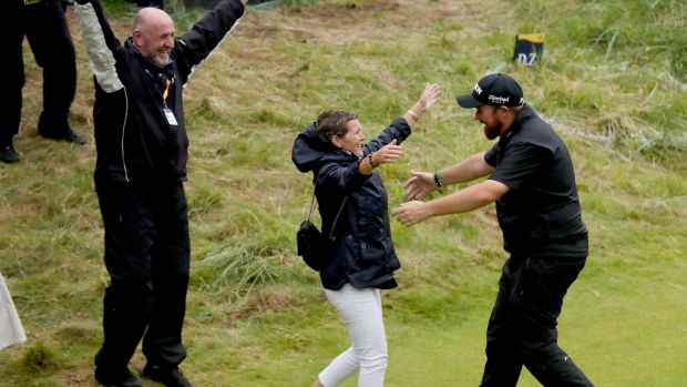 Shane Lowry celebrates with his parents Bridget and Brendan after winning the British Open at Portrush. Photo: Oisin Keniry/Inpho