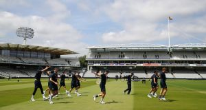 The England team warm up ahead of the Test match against Ireland at Lord's. Photo: Julian Finney/Getty Images