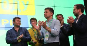 Ukraine's president Volodymyr Zelenskiy (centre) reacts at his party's headquarters after the parliamentary elections in Kiev on Sunday. Photograph: Tatyana Zenkovich/EPA