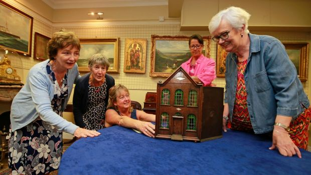 Volunteers from the children's charity. Tara's Palace, from left, Patricia Woods, Roslyn Nicholson, Jenny Johnston, Anne Lawless and Mary Moore with the doll's house. Photograph: Nick Bradshaw