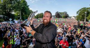 Shane Lowry with the Claret Jug at Clara GAA grounds. Photograph: Morgan Treacy/Inpho