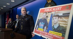 Security camera images of suspects Kam McLeod (19) and Bryer Schmegelsky (18) are displayed during a news conference where police said the two British Columbia teenagers - who were first thought to be missing - are now considered suspects in the deaths of three people. Photograph: Darryl Dyck/The Canadian Press/AP.
