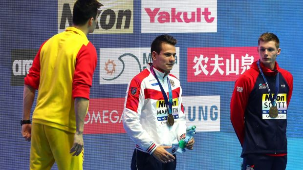 "China's gold medallist Sun Yang shouts ""You're loser, I'm a winner, yes!"" to Britain's Duncan Scott during the medal ceremony for the Men's 200m Freestyle final. Photograph: Getty Images"