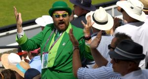 An Ireland fan celebrates as England are bowled out before lunch during day one of the  Test match between England and Ireland at Lord's Cricket Ground on in London on Wednesday. Photograph: Stu Forster/Getty Images