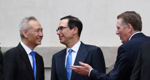 Chinese vice premier Liu with US treasury secretary Steven Mnuchin and trade representative Robert Lighthizer in May. Photograph: Clodagh Kilcoyne/Reuters