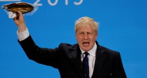 UK prime minister Boris Johnson holds a plastic wrapped kipper fish during a hustings event in London on July 17th, 2019. Photograph: Peter Nicholls/Reuters.