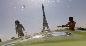 Trocadero Fountains next to the Eiffel Tower in Paris as a new heatwave hits Europe. Photograph:  Dominique Faget/AFP/Getty