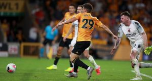 Ruben Vinagre of Wolverhampton Wanderers scores their second goal  during the  Europa League second qualifying round first leg against Crusaders at Molineux. Photograph: David Rogers/Getty Images