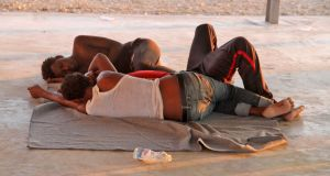 Rescued migrants sleep on the coast of Khoms, Libya. Photograph: AFP/Getty