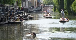 A woman swims in the River Cam  in Cambridge on Thursday: Photograph: Leon Neal/Getty Images