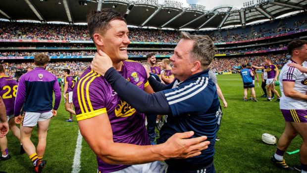 Wexford's Lee Chin celebrates with manager Davy Fitzgerald after the the Leinster final victory over Kilkenny. Photograph: Ryan Byrne/Inpho