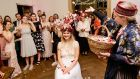 Lisa McNamee: A rose crown was placed on the bride's head, and she was seated in the centre of a large circle.