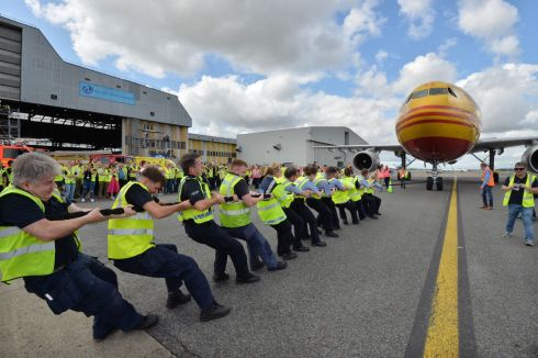 Members of Dublin Aerospace, DHL, DAA, Swissport, Dublin Fire Brigade, Boeing and gardai  participate in the fourth annual  Plane Pull of a  DHL A300 Cargo Aircraft for a 10m stretch in aid of Aoibheann's Pink Tie Childrens Cancer Charity alongside Children from St. John's ward, Crumlin Hospital.  Photograph: Alan Betson/The Irish Times