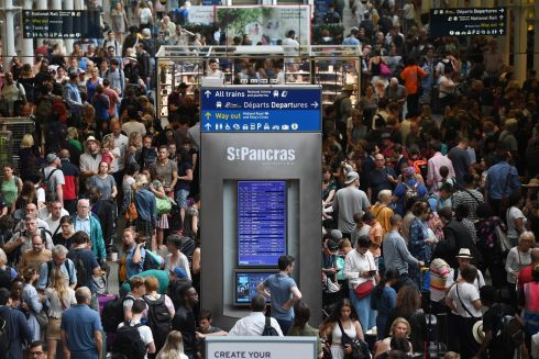 Commuters wait for Euro Star trains from London to Paris at St Pancras station in London where services have been disrupted due to an overhead power line problem caused by the heatwave.  Photograph: Andy Rain/EPA
