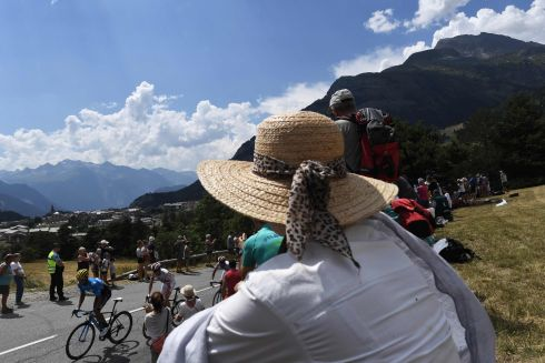 Fans look at Costa Rica's Andrey Amador (left) and Ireland's Dan Martin ascending during the 19th stage of the Tour de France. Photograph: Jeff Pachoud/Getty