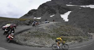 France's Julian Alaphilippe, wearing the overall leader's yellow jersey, takes a curve during the 19th stage  between Saint-Jean-de-Maurienne and Tignes on Friday. Photograph: Jeff Pachoud/AFP/Getty Images