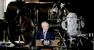 British prime minister Boris Johnson gives a speech in front of a Stephenson's Rocket at the Science and Industry Museum in Manchester. Photograph: Lorne Campbell/Pool via Reuters