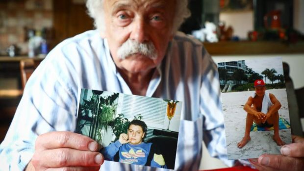 Andrzej Wasikiewicz holds photographs of his son, Michal, at his home in Wloclawek, Poland. Photograph: Beata Zawrzel for The Irish Times