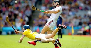 Wexford's Dylan Whelan attempts to block Paddy Cummins of Galway. Photograph: Ryan Byrne/Inpho