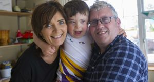 Cian Mulry with his parents, Liz and Tommy. Photograph: Brian Farrell