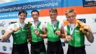 Ireland's Miles Taylor, Ryan Ballantine, Hugh Sutton and Eoin Gaffney celebrate their bronze medal. Photograph: Detlev Seyb/Inpho