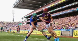 Wexford's Jack O'Connor nutmegs Cathal Barrett of Tipperary. Photo: Tommy Dickson/Inpho