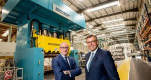 Jonathan Holmes, managing director, Creative Composites with Alastair Hamilton, chief executive of Invest NI
