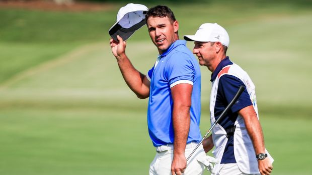 Brooks Koepka tips his cap as he walks off the 18th green after winning the WGC-FedEx St Jude Invitational at TPC Southwind in Memphis, Tennessee. Photograph: Tannen Maury/EPA