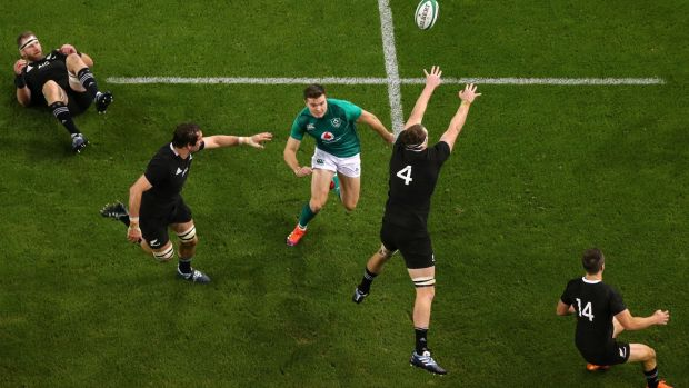 Jacob Stockdale en-route to scoring his try against the All Blacks in November 2018. Photograph: Tommy Dickson/Inpho