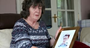 Patricia Douglas with a photograph of her  son, Sean, who went missing in Co Clare in 1998. Photograph: Stephen Davison