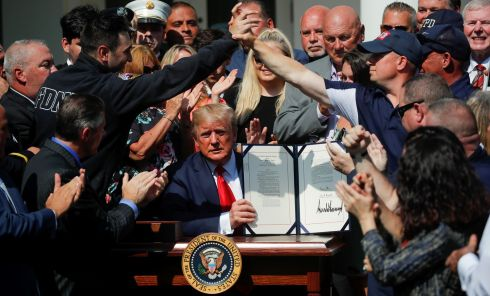 SIGNED: New York City first responders celebrate as US president Donald Trump displays the 'Permanent Authorization of the September 11th Victim Compensation Fund Act' during a signing ceremony in the Rose Garden of the White House in Washington. Photograph: Carlos Barria/Reuters