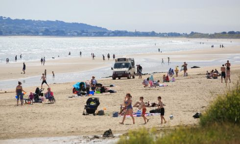 WARM WEATHER: Members of the public enjoying the good weather on Portmarncok Beach, Dublin. Photo: Gareth Chaney/Collins